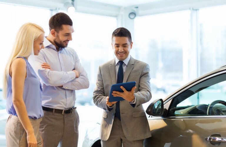 young couple learns about leasing and financing options