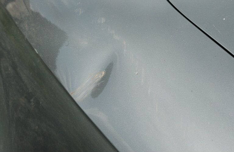 Damage Protection dent in car wing
