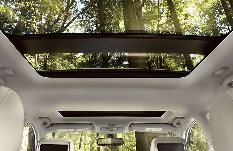 2020 Nissan Pathfinder interior shot showing dual panel moonroof and backs of headrests