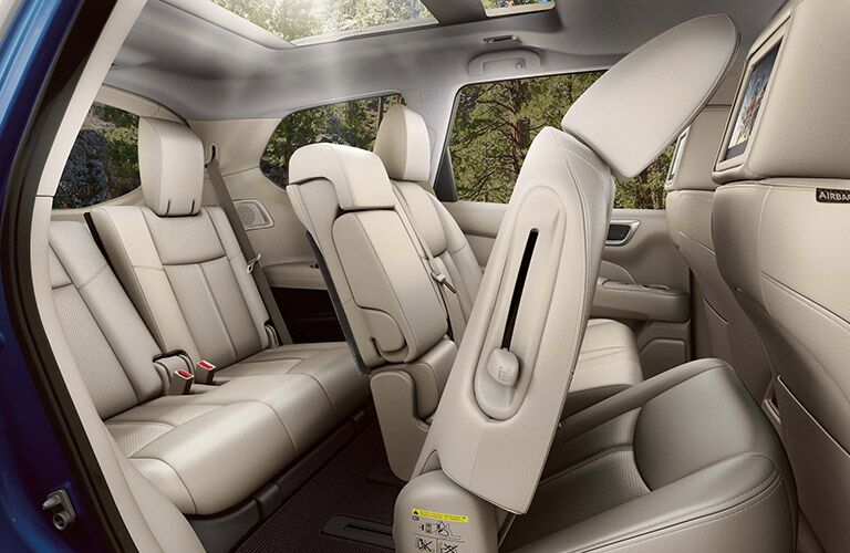 2020 Nissan Pathfinder interior shot showing one seat collapsed for entry to third row