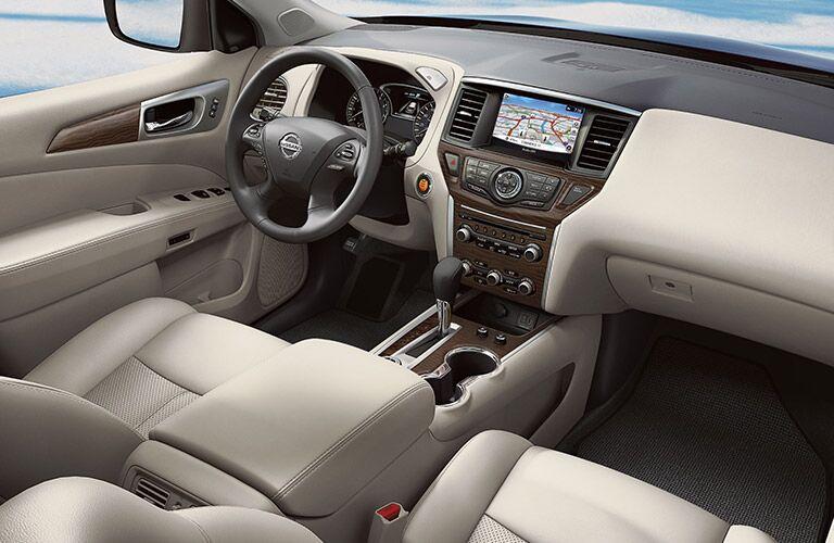 2020 Nissan Pathfinder interior shot showing front seats steering wheel doashboard and floor mats