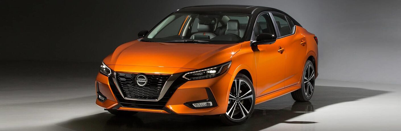 2020 Nissan Sentra orange and black exterior paint colors parked in blank room