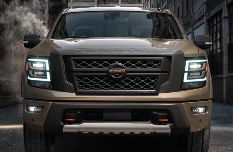 front of brown 2020 Nissan Titan