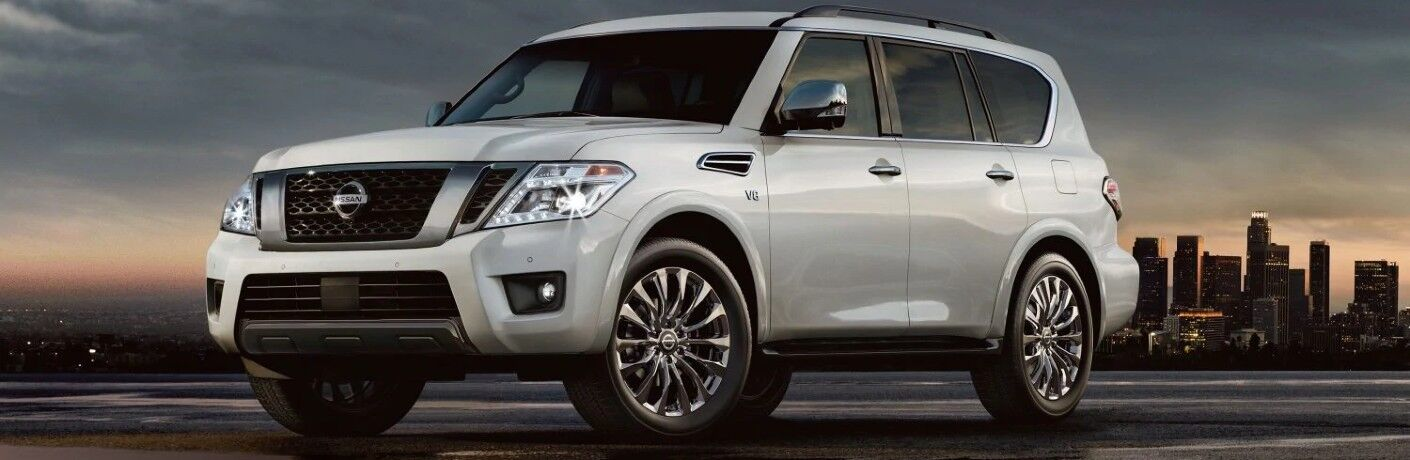 2020 Nissan Armada grey paint parked on roof showing front and driver side cityscape background