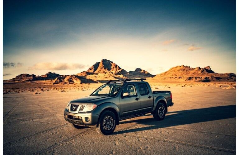 2020 Nissan Frontier grey parked on desert ground with vignette