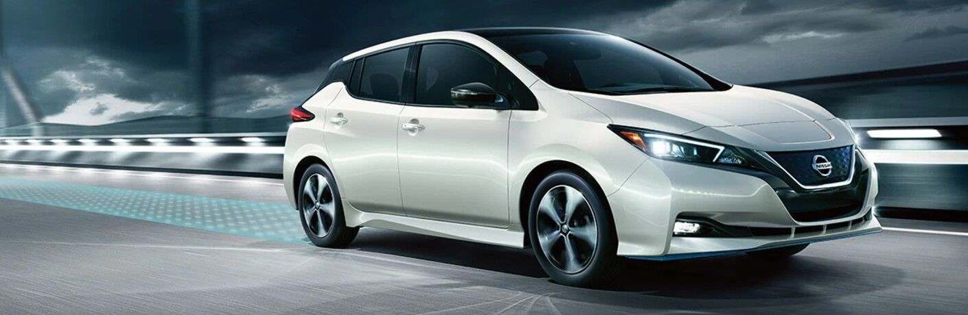 2020 Nissan Leaf White futuristic shot driving to the right