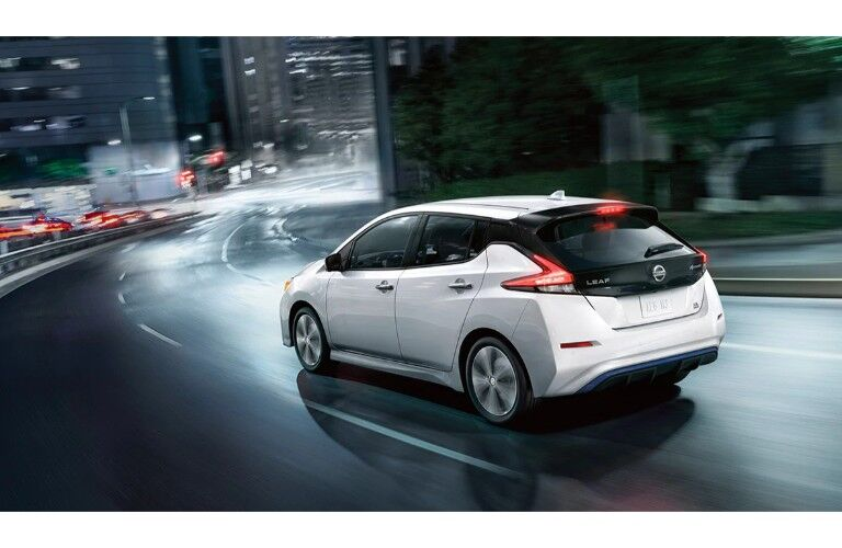 2020 Nissan Leaf white paint driving away from shot