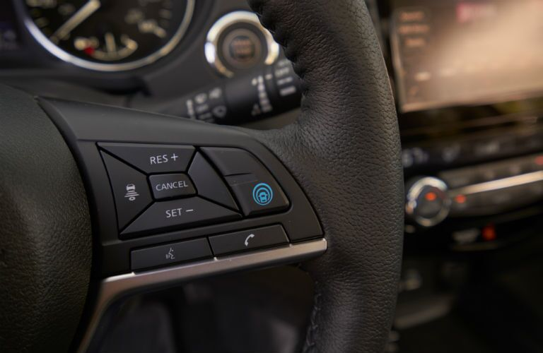 Closeup of controls on steering wheel in 2020 Nissan Rogue