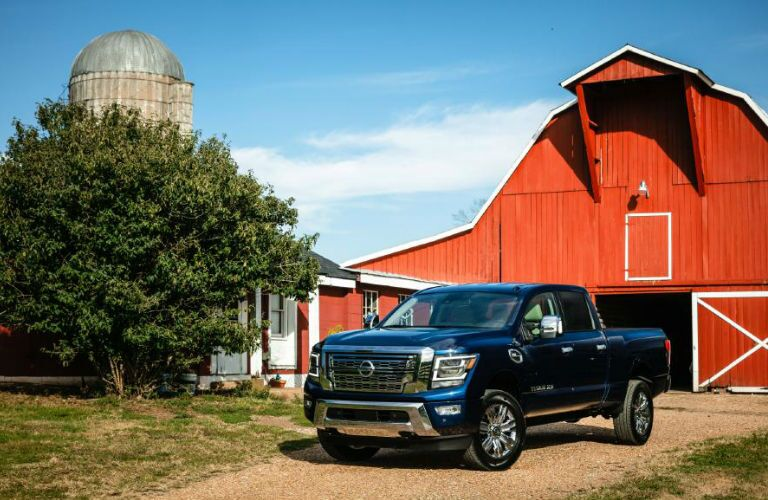 2020 Nissan TITAN XD parked in front of a barn