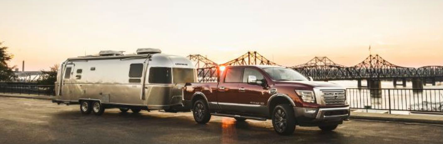 2020 Nissan TITAN XD towing a camper