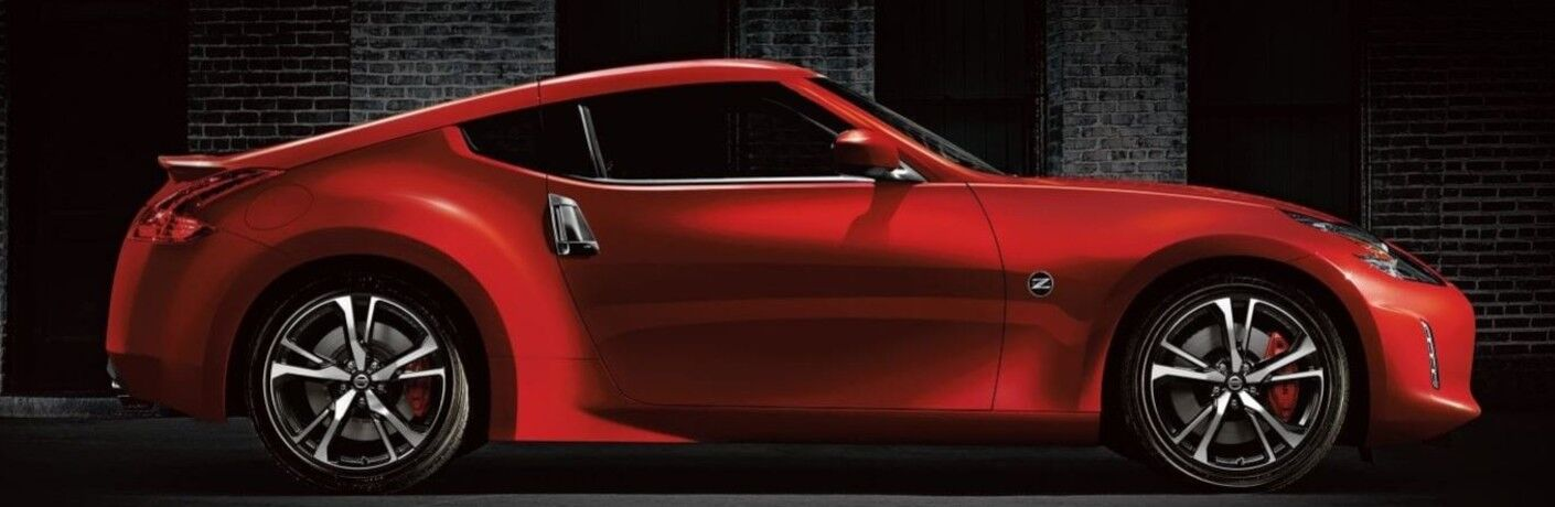 2020 Nissan 370Z red profile shot parked in front of brick building