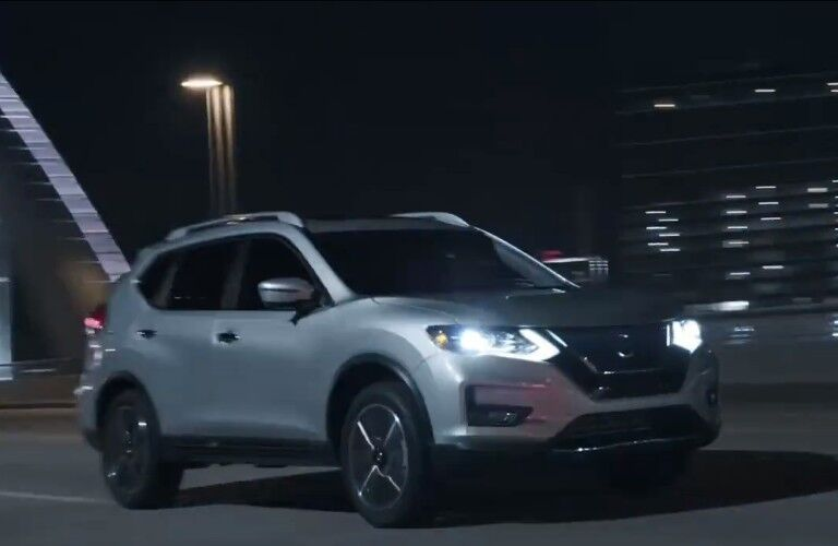 2020 Nissan Rogue driving through the night