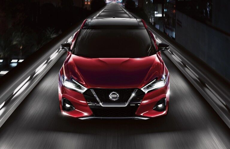 front of red 2020 Nissan Maxima