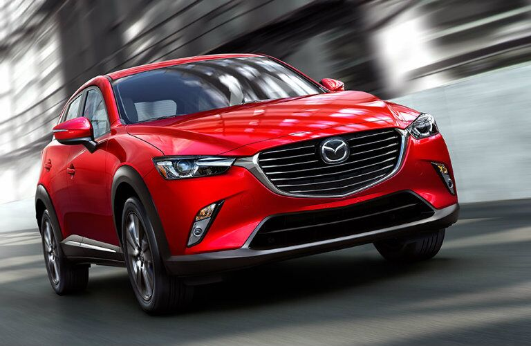 2016 mazda cx-3 driving down the highway