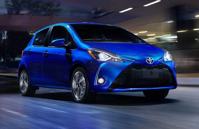 blue toyota yaris driving at night