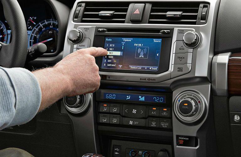 man using toyota 4runner touchscreen