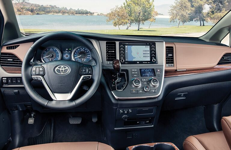 Brown dashboard and front seats in 2020 Toyota Sienna