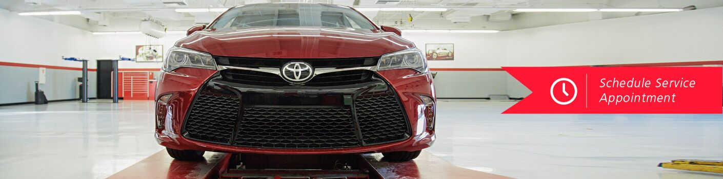 front view of red toyota in service shop, schedule appointment link