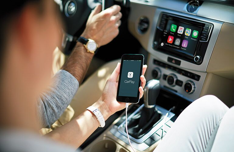 A women using the 2016 VW CC's Apple CarPlay technology