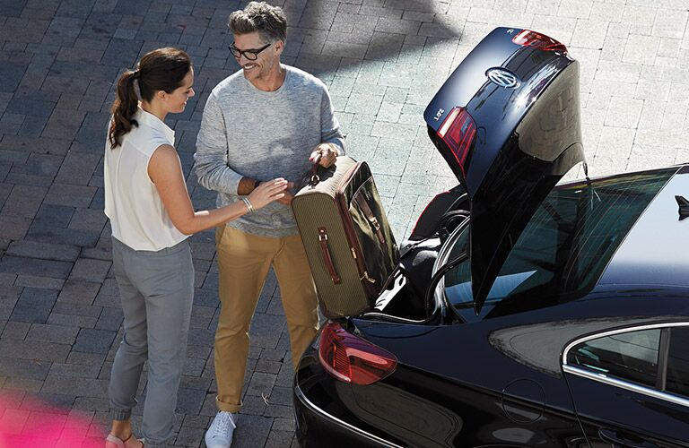 A couple put luggage in the 2016 Volkswagen CC's trunk