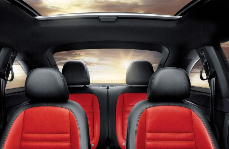 Image of the 2017 Volkswagen Beetle's black and red seats from the dashboard