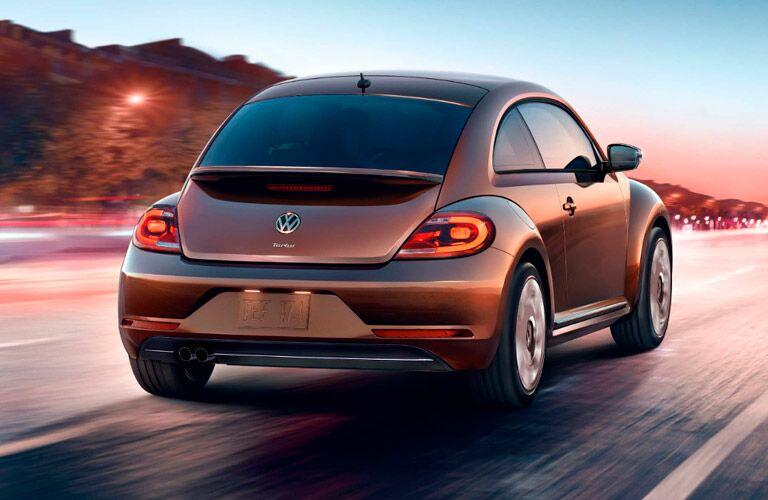 Bronze 2017 Volkswagen Beetle driving down a highway