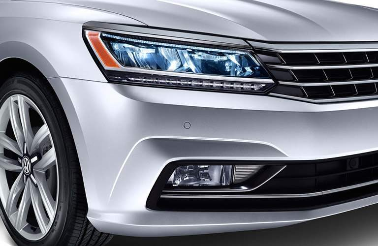 Silver Volkswagen Passat headlights and grille