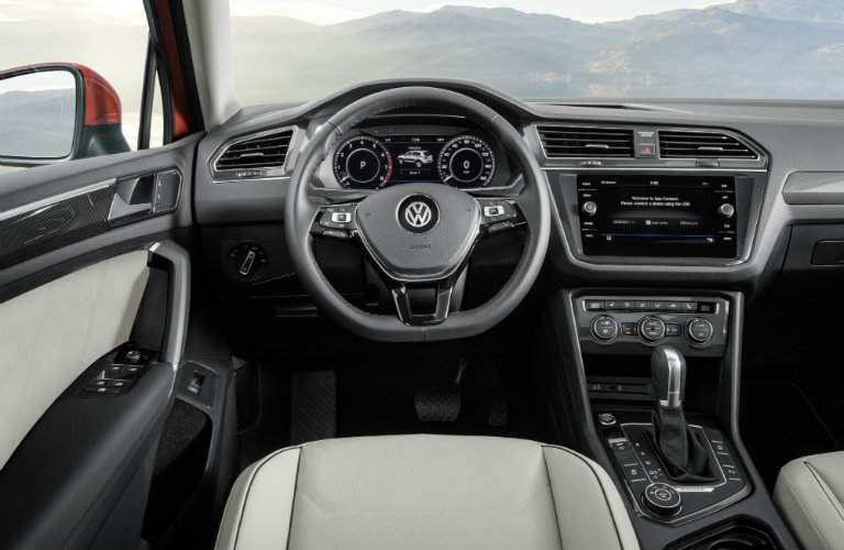 Front dash of 2018 Volkswagen Tiguan with steering wheel and VW Car-Net App-Connect infotainment system