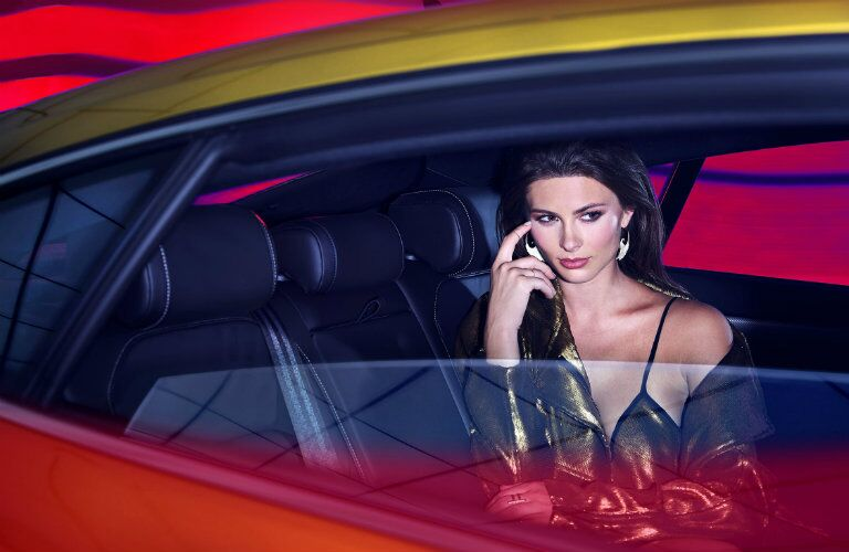 Fashion model sitting in the back seat of the 2019 VW Arteon photographed by Douglas Sonders