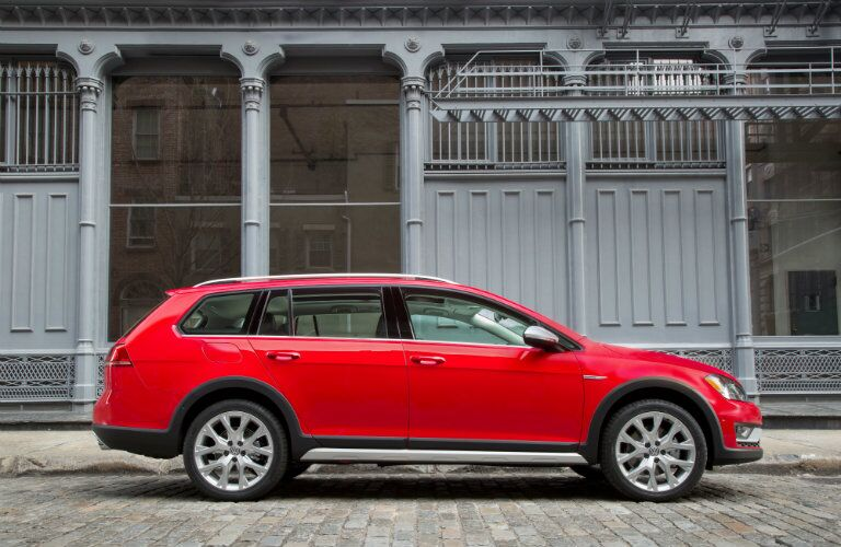 Side profile of red 2017 Volkswagen Golf Alltrack