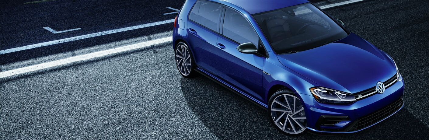 Overhead view of blue 2019 Volkswagen Golf R on city street