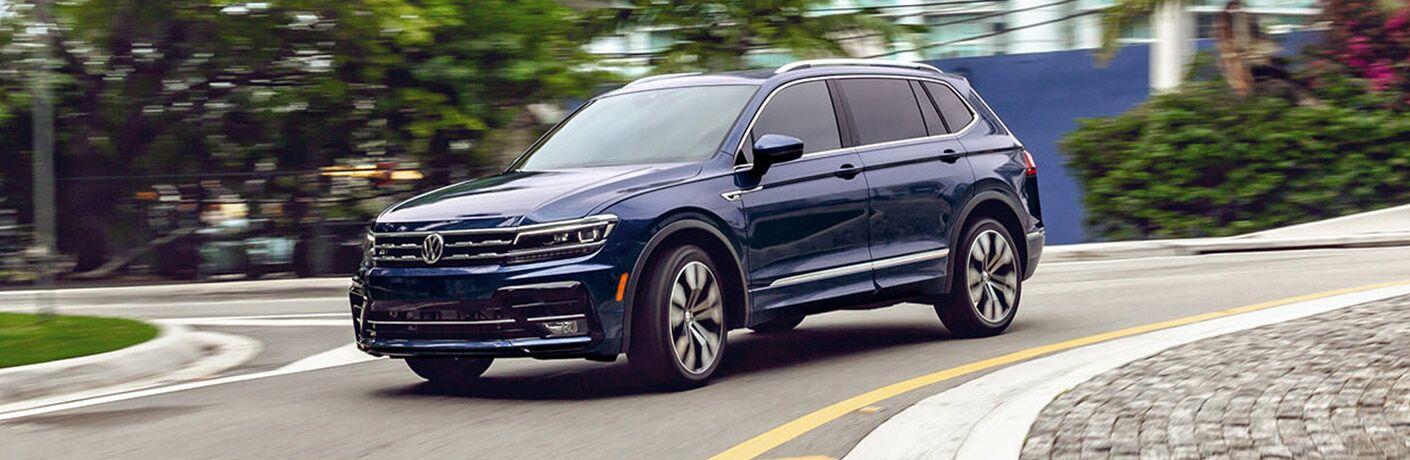 A 2021 Volkswagen Tiguan driving down a road