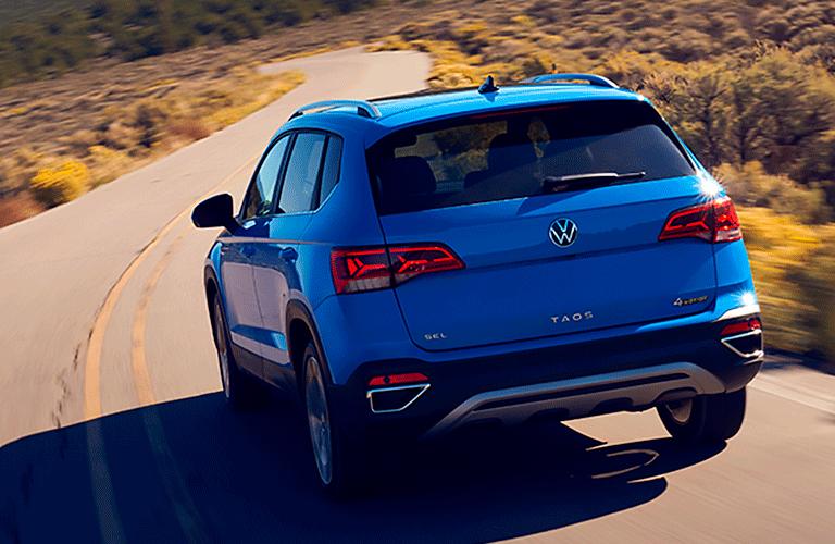 rear view of 2022 VW Taos driving away
