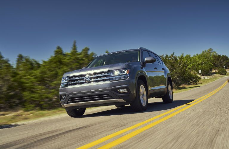 front of a grey 2018 Volkswagen Atlas driving on the road