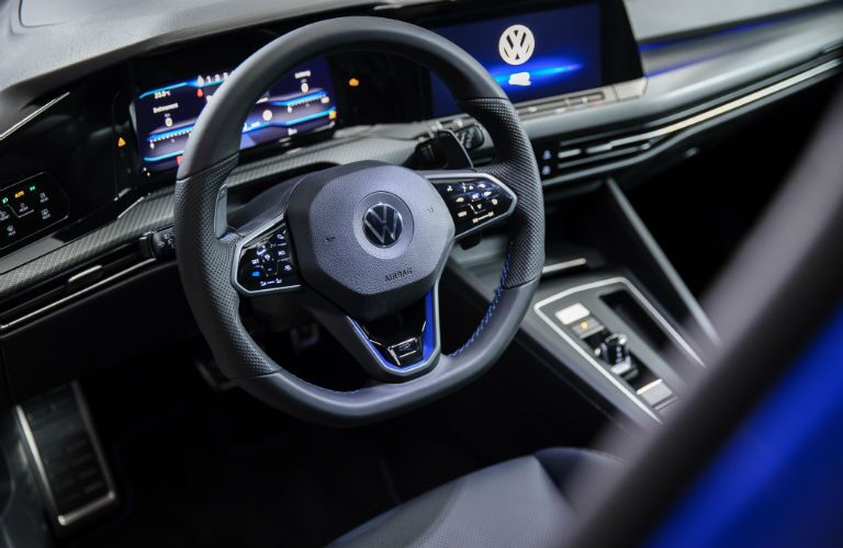 A photo of the driver's cockpit in the 2022 Volkswagen Golf R.