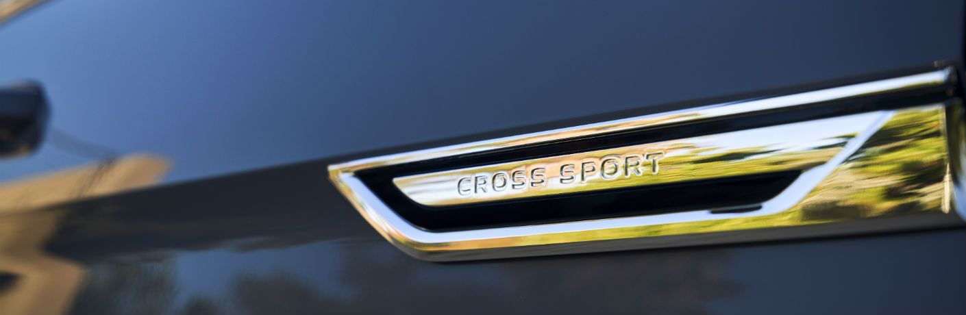 A photo of the Cross Sport badge used by the 2020 Volkswagen Atlas Cross Sport.