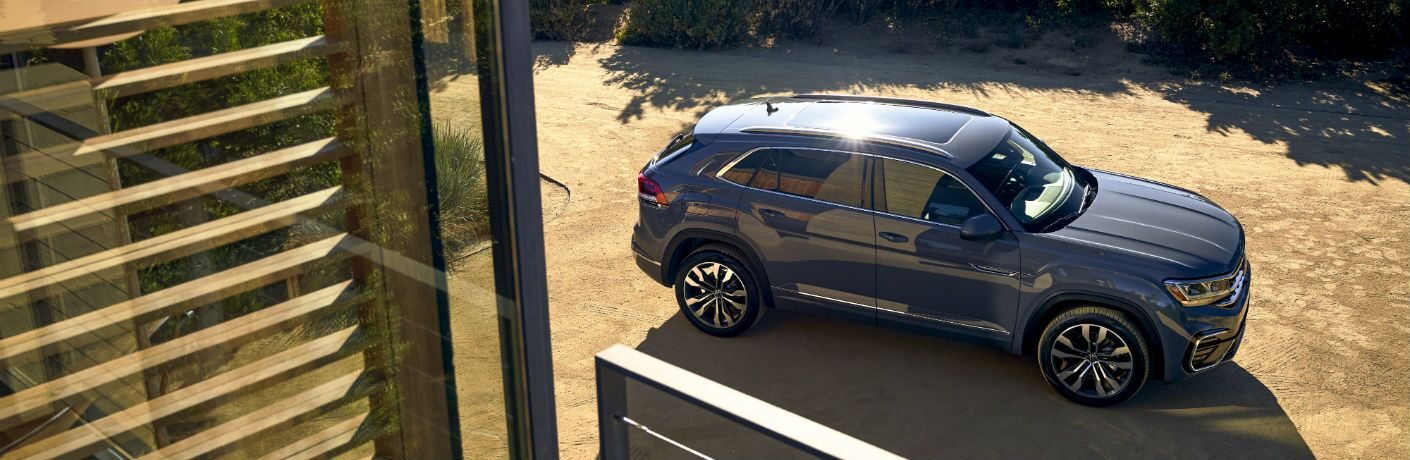 An overhead photo of the 2020 Volkswagen Atlas Cross Sport parked outside a home.