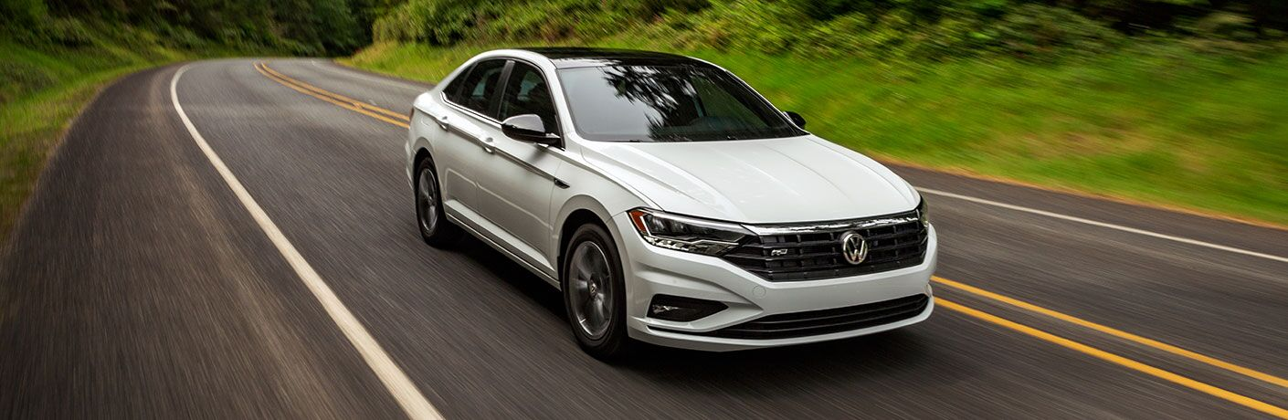 A front left quarter photo of the 2020 Volkswagen Jetta in motion on the road.