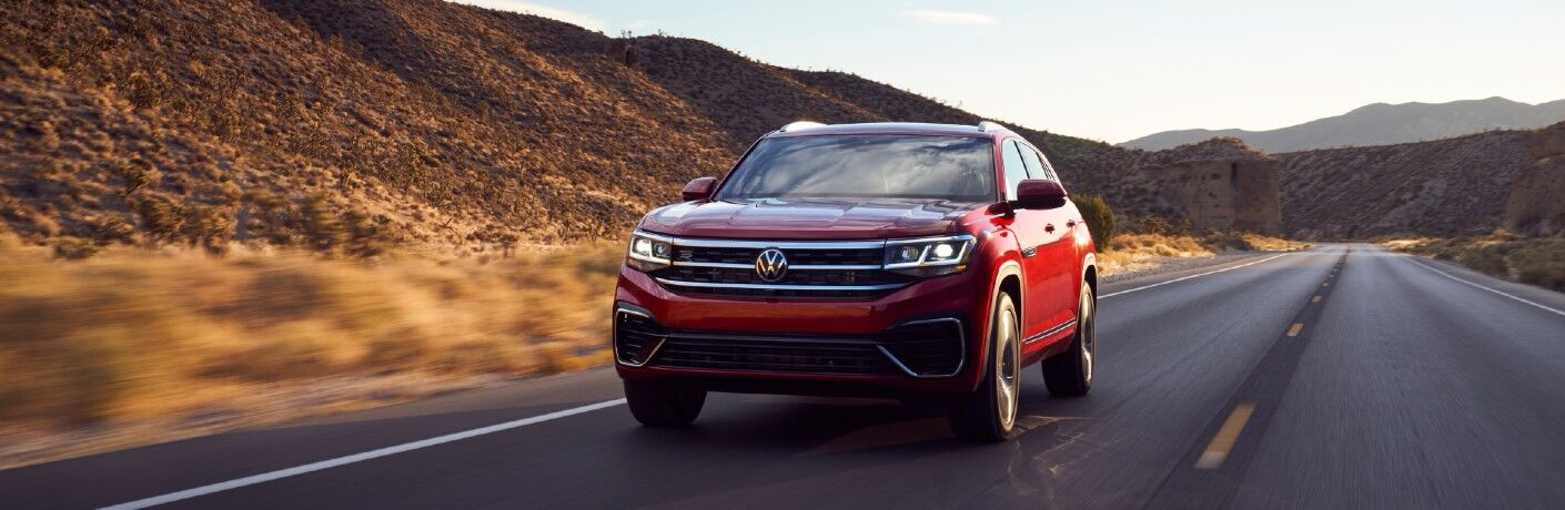A head-on photo of the 2021 Volkswagen Atlas Cross Sport on the road.