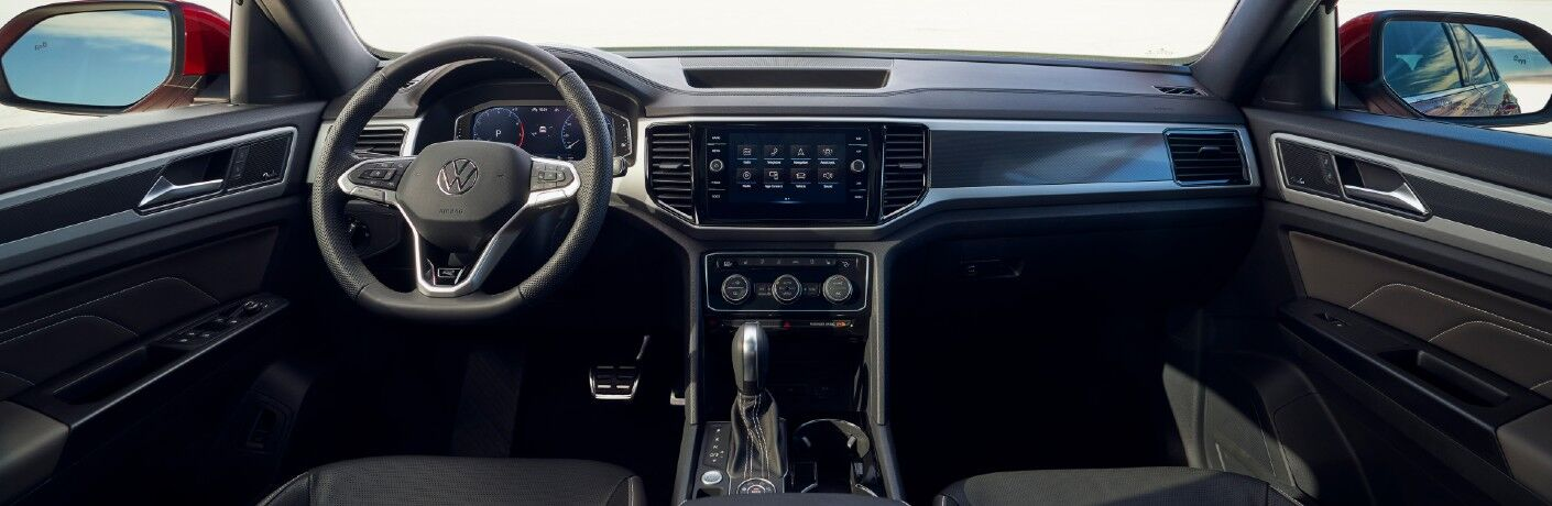 A photo of the dashboard and driver's cockpit in the 2021 Volkswagen Atlas Cross Sport.