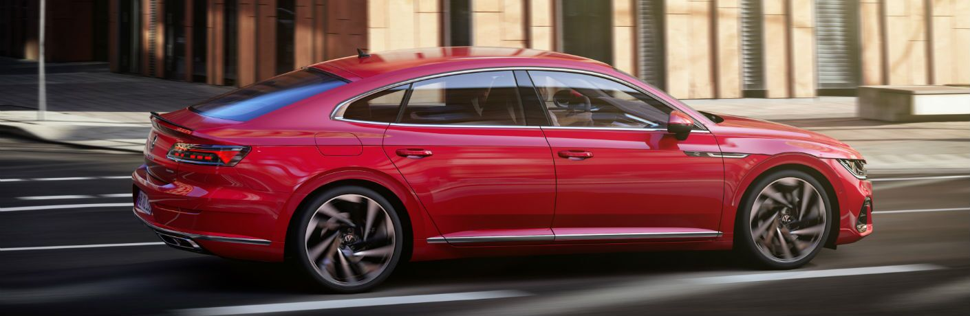 A right profile photo of the 2021 Volkswagen Arteon in motion on the road.