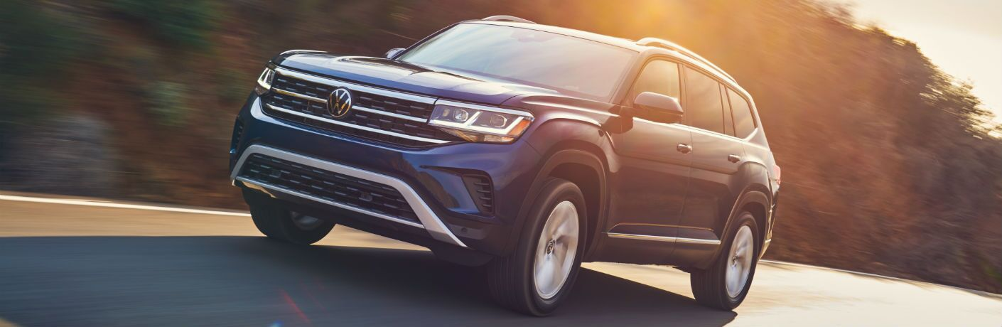 A front-end photo of the 2021 Volkswagen Atlas on the road.
