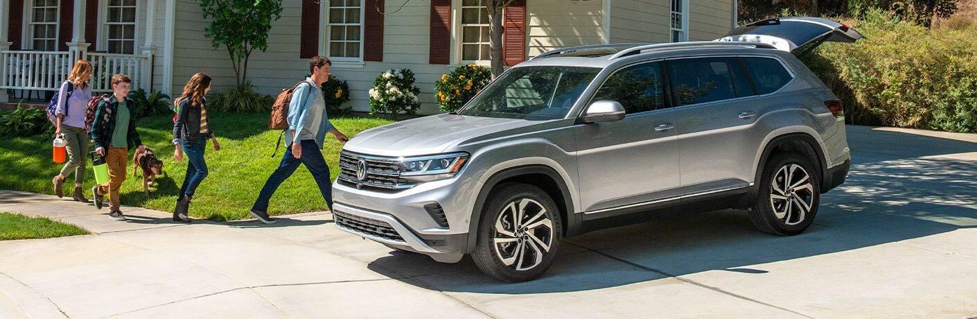 A left profile photo of the 2021 Volkswagen Atlas in a driveway.