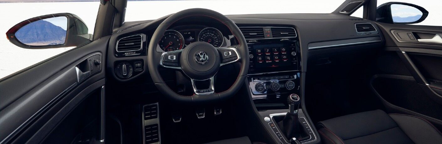 A photo of the driver's cockpit in the 2021 Volkswagen Golf GTI.