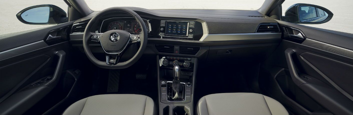 A photo of the dashboard and driver's cockpit in the 2021 Volkswagen Jetta.
