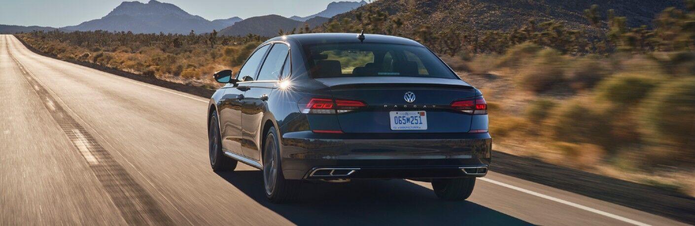 The rear of the 2021 Volkswagen Passat on a desert road.