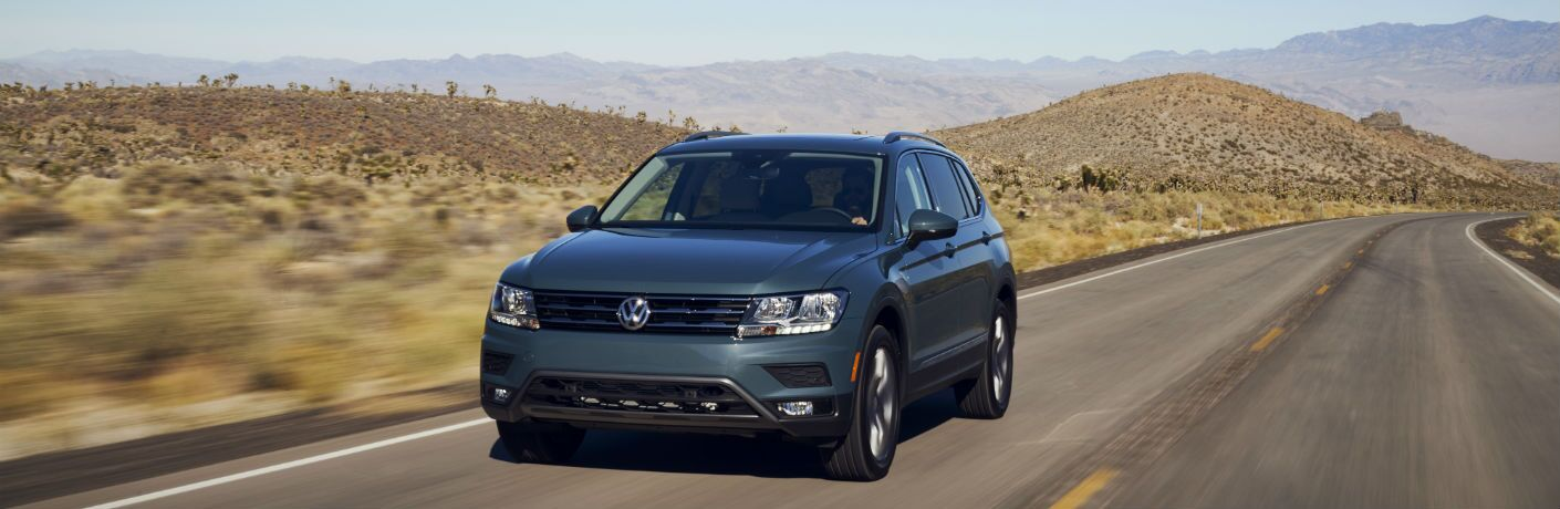 A head-on photo of the 2021 Volkswagen Tiguan on the road.