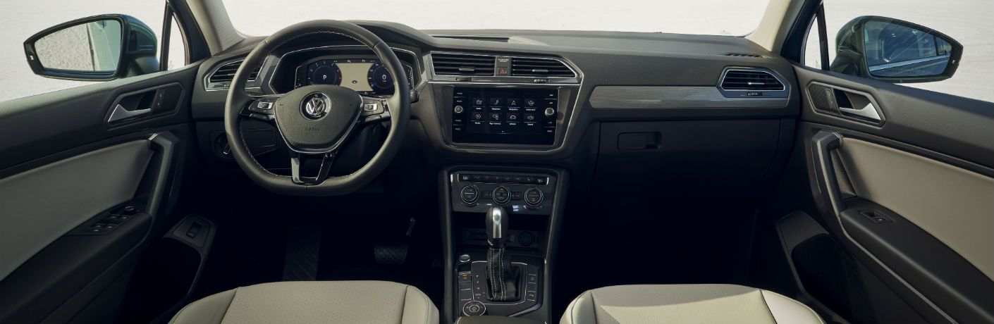 A photo of the dashboard and driver's cockpit in the 2021 Volkswagen Tiguan.