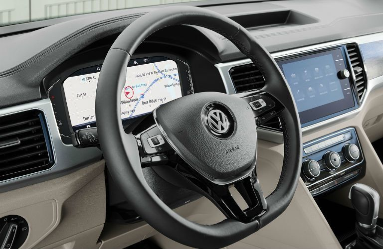 A photo of the steering wheel and digital gauge cluster in the 2020 VW Atlas.