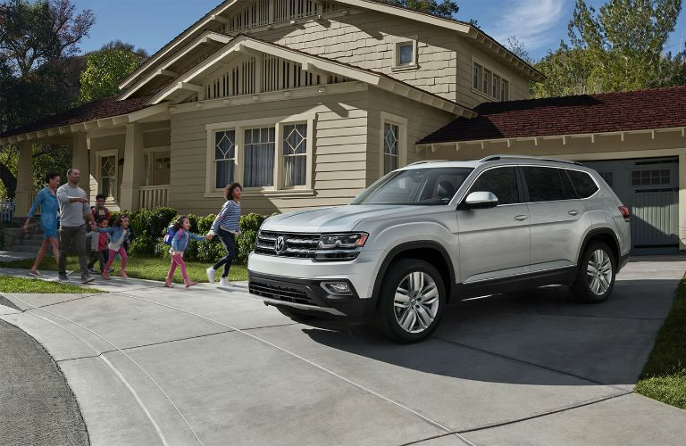A photo of the a family getting into the 2019 VW Atlas.